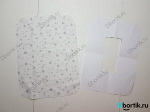 Кусок ткани открепленный от выкройки.