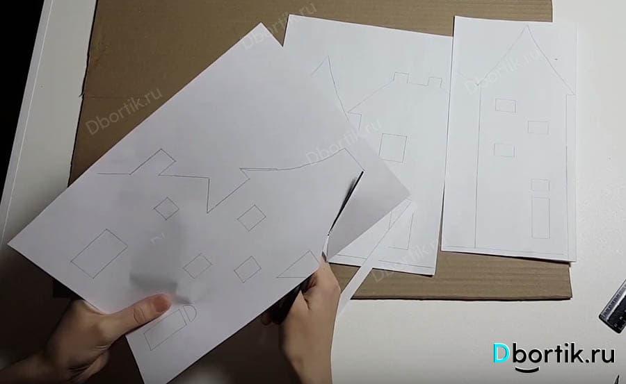 Шаблон, бумага формата А4 разрезается по намеченным линиям. На фото рука и ножницы разрезают бумагу.